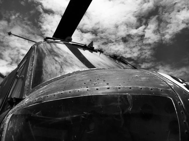 worn and rusted military helicopter in black and white